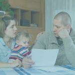 worried family with financial documents at home